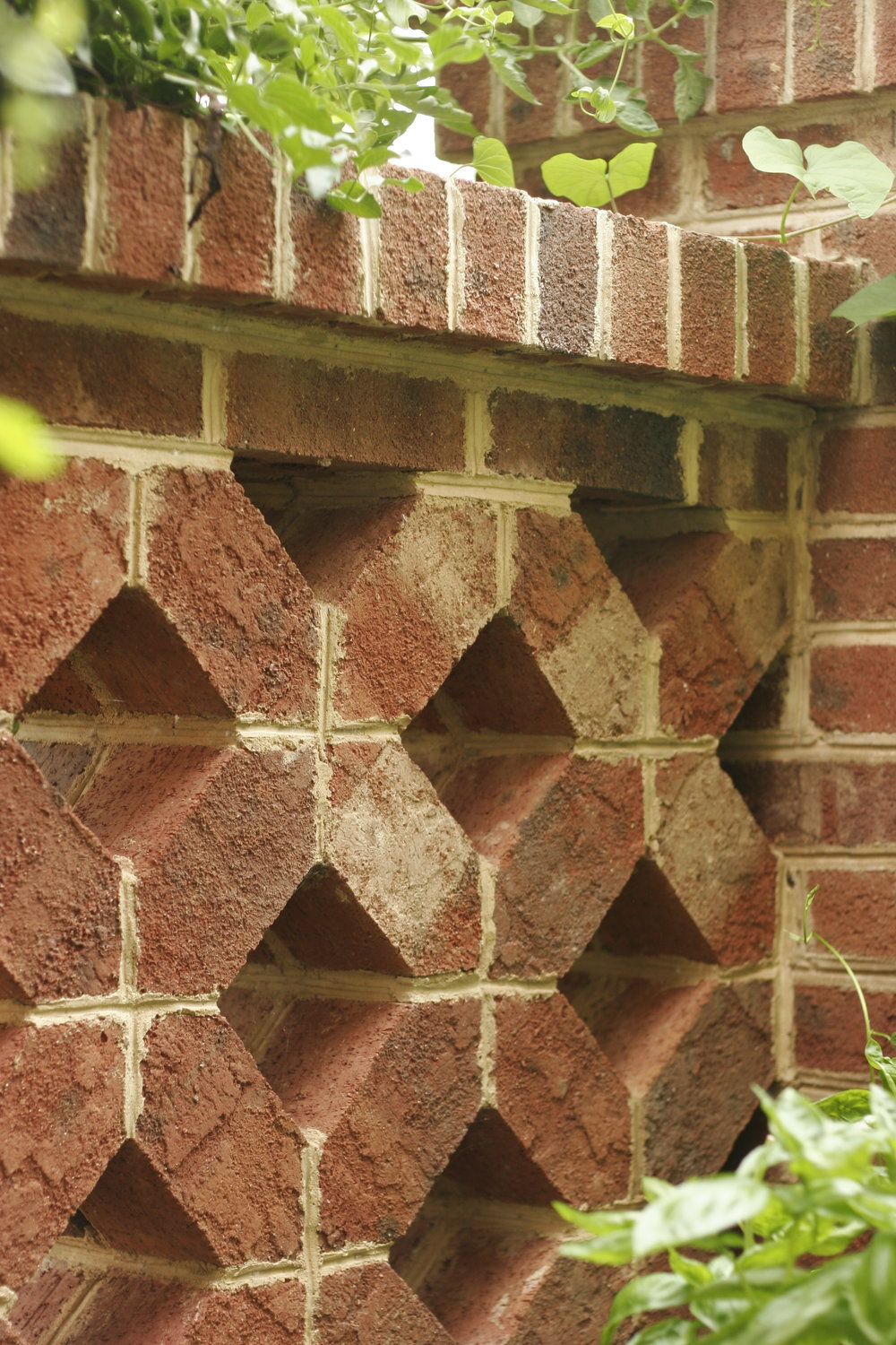 "A close-up of the incredible ""pierced"" brick boundary wall, all custom cut on-site"