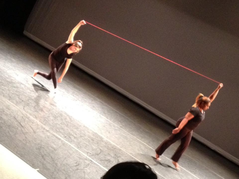 Choreographer Christopher K. Morgan uses red string to help dancers Lauren Van Vleet and Tiffany Ashton establish dynamic tension. It helps me see ubuntu in the negative space.