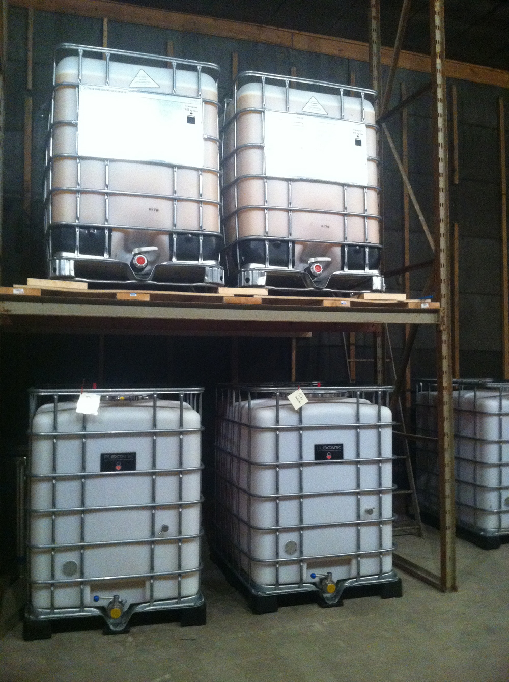 Containers full of fermenting cider.
