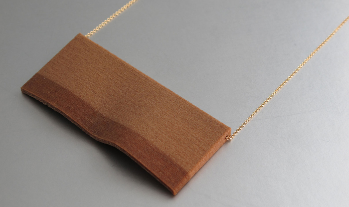 Boreal  is a series of elegant necklaces that features a never-before-seen material used in its pendants – 3D printed WOOD!