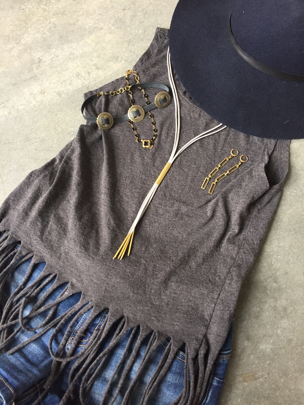 Chokers, Bolos, and dangle earrings paired with a fringe crop top and cut offs.