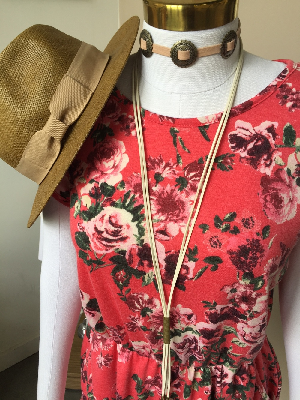 If a bit more color is what you're looking for, try a floral romper with a bolo and western inspired choker.