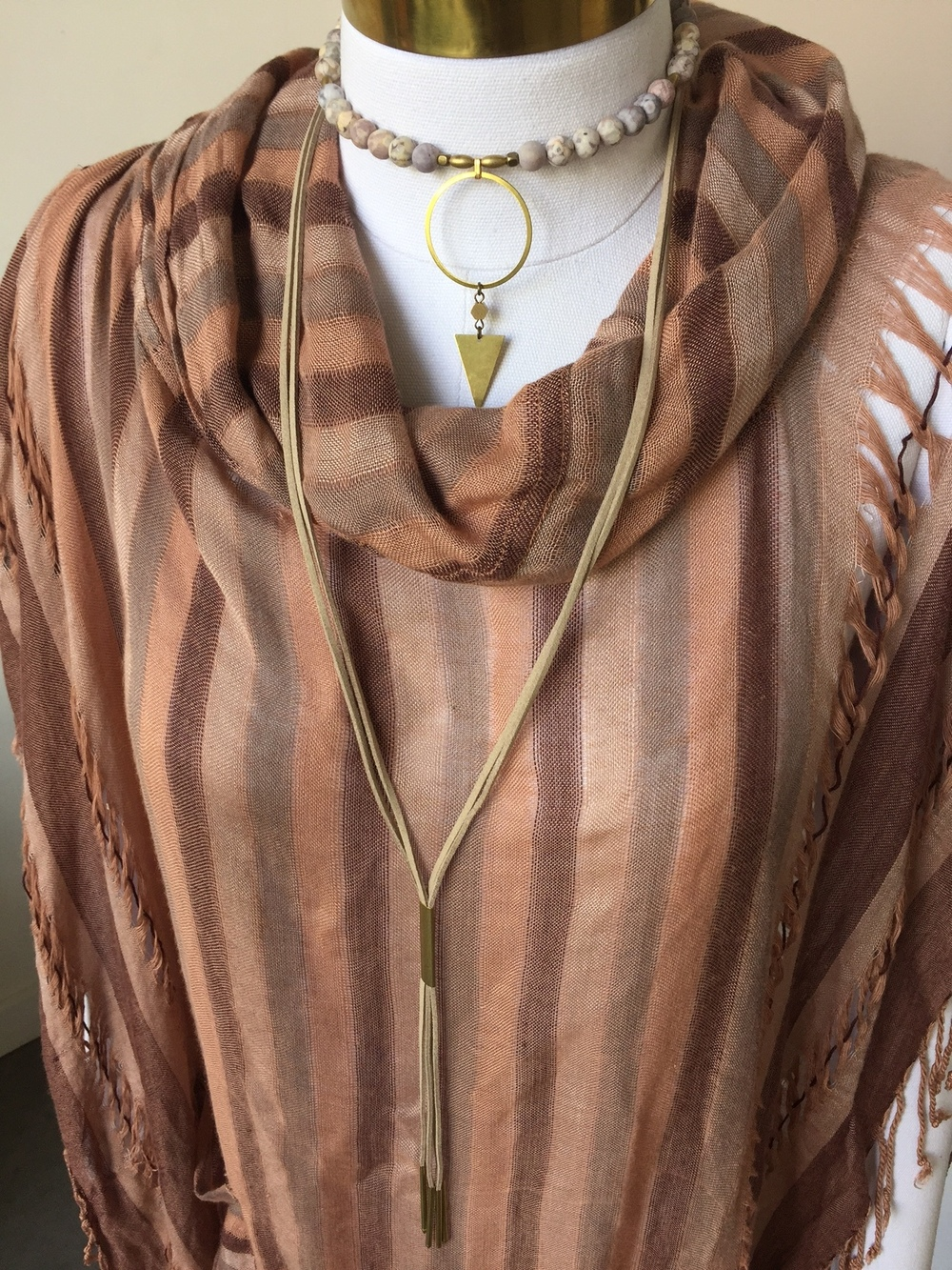 And if you're still looking to keep it a bit boho, try a poncho with one of our bolos and a beaded choker.