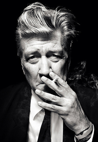 David Lynch smoking a cigarette and judging you.