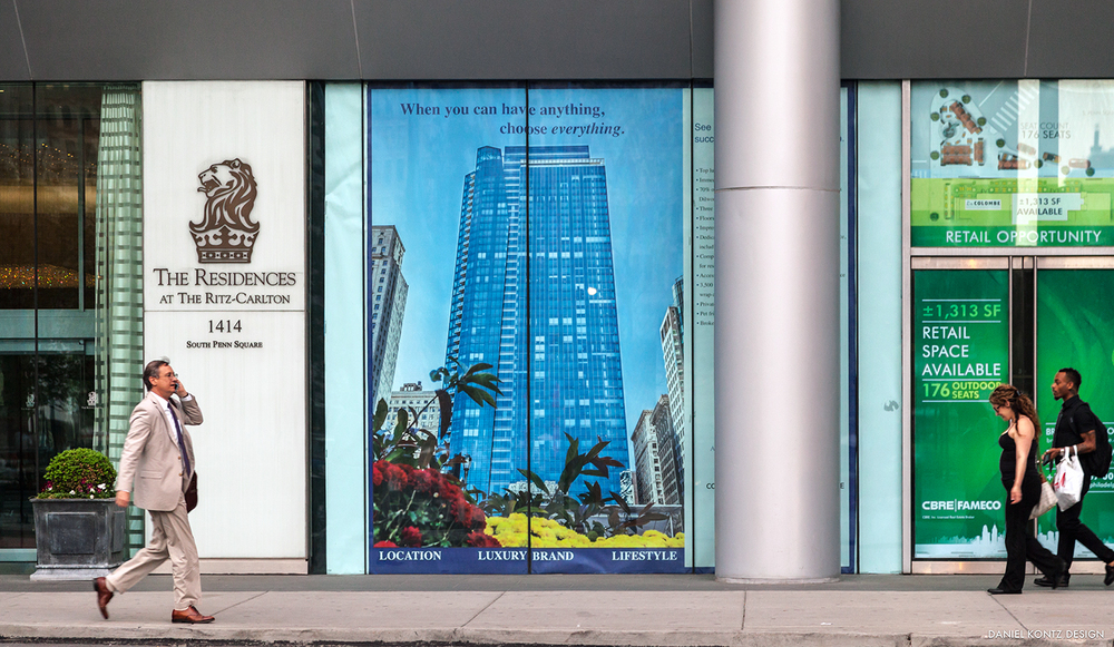 Window-front advertisement on the 1st floor of the Residences at the Ritz-Carlton