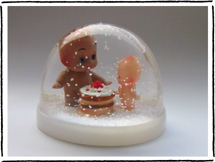 The Kewpie and Cake snowglobe.  Buy it here .