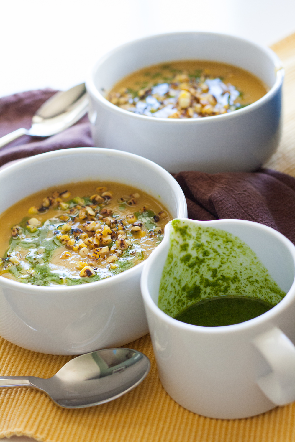 delicata squash soup with charred corn and cilantro oil