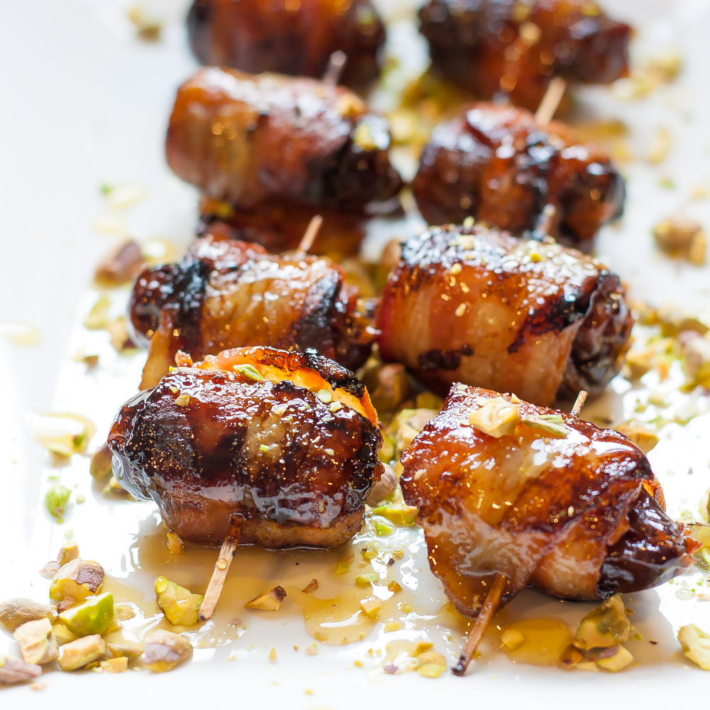 bacon wrapped dates with maple glaze and pistachios