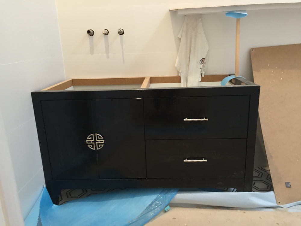 The main bathroom vanity - looking forward to seeing it with the white stone top and basin.