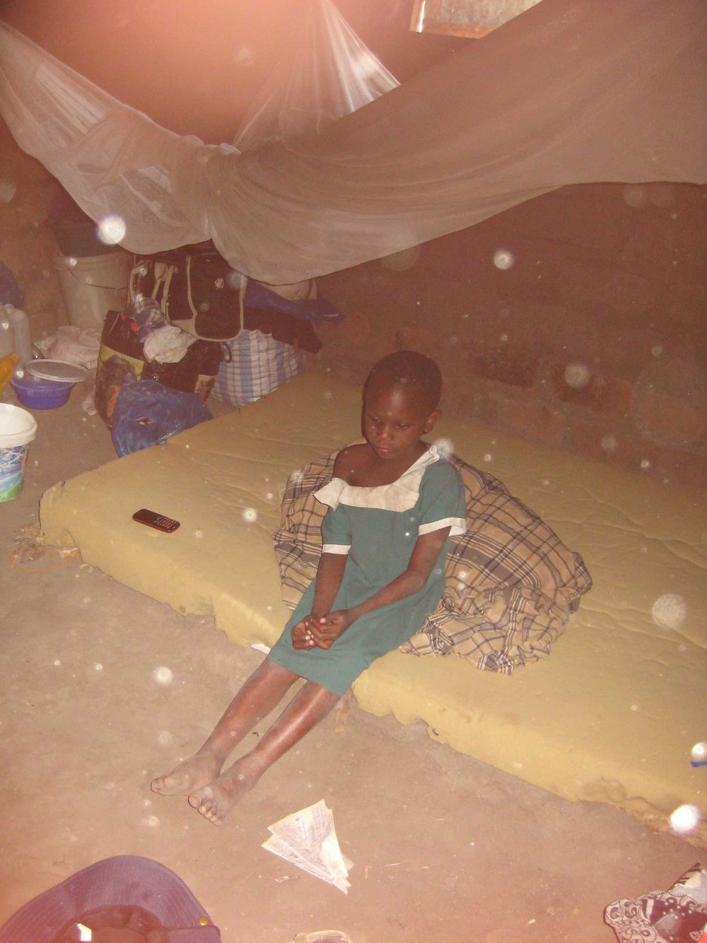One of her family members sitting on the bed (Photo by Miango ©)