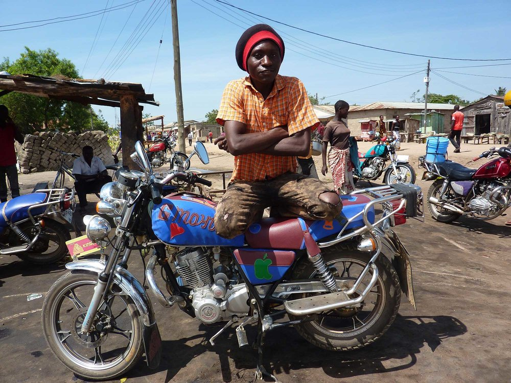 A young Tanzanian posing with his decorated motorcycle. ( Photo by Kajula © )