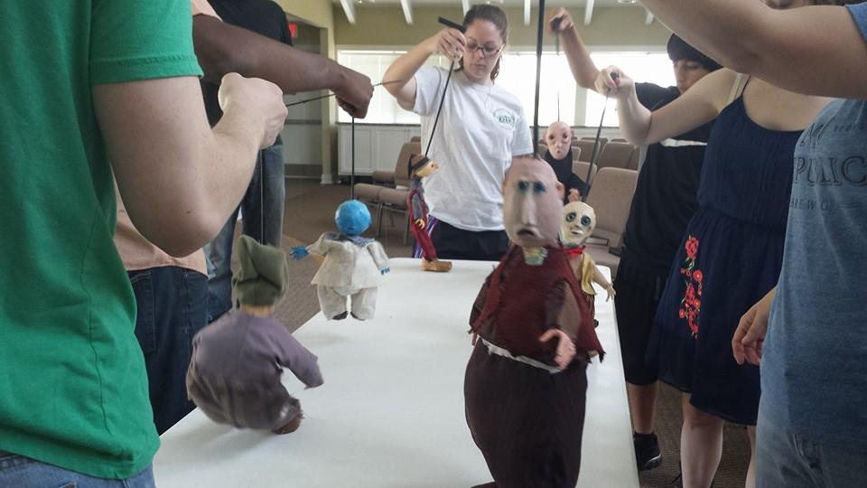 The Ensemble in a puppetry class taught by Trouble Puppet from Austin