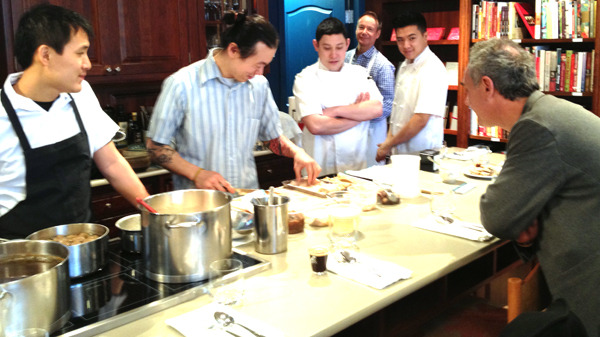 Celebrated chef Ferran Adria of elBulli Foundation watches as Jack Chen and David Gunawan of Farmer's Apprentice and Quang Dang and Alex Hon of West prepare brunch at Books to Cooks in Vancouver on March 9. — Image Credit: Martha Perkins