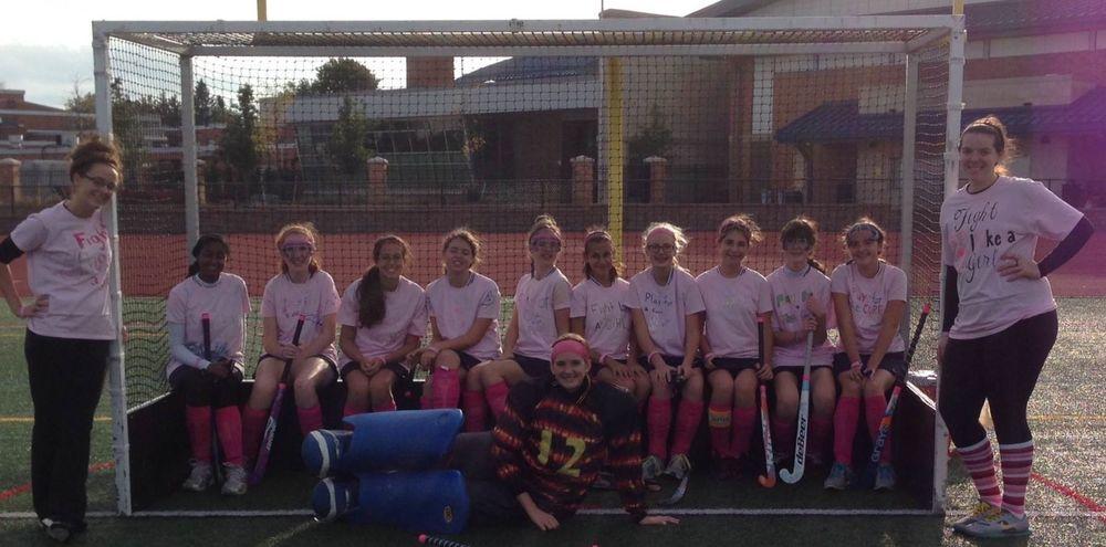 JV team wearing their pink.