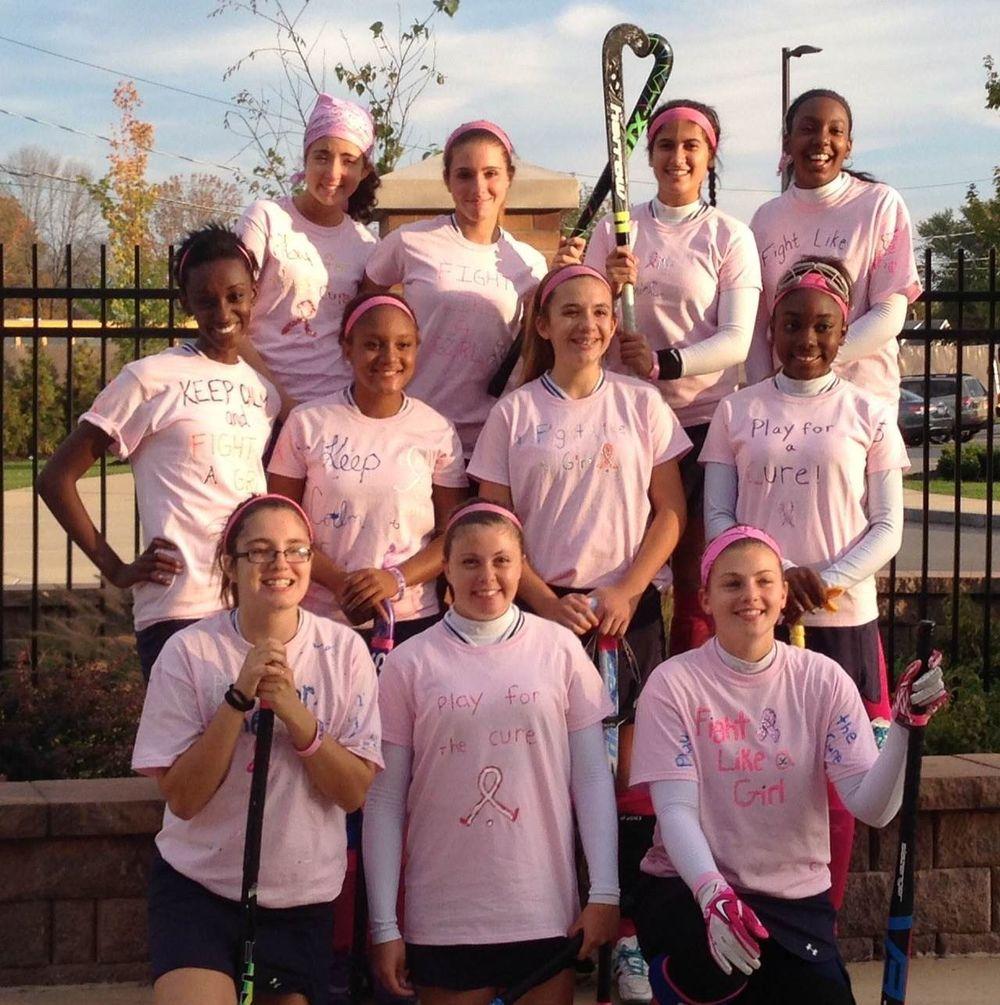 Varsity team wearing their pink.