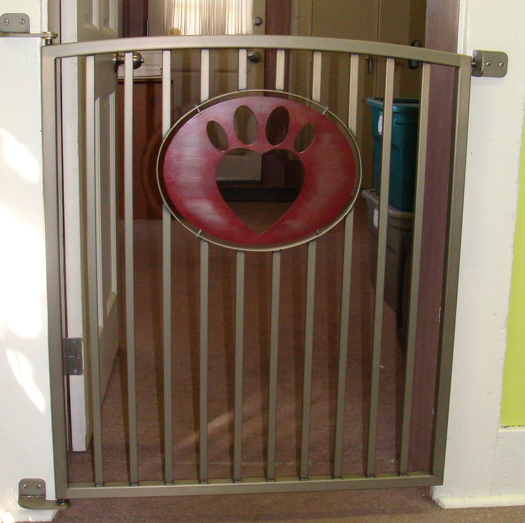 A custom steel dog gate donated to the Humane Society of Indianapolis for use in their administrative offices.