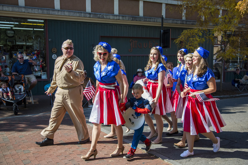 The Jonesborough Repertory Theatre's actors for the 1940's USO Show walk into the sunlight moments before the Fourth of July parade begins.