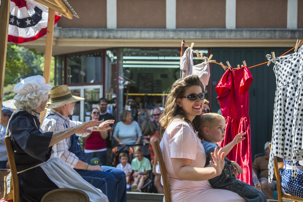 40's-style outfits hang on a clothesline on a float during the Jonesborough Days parade.