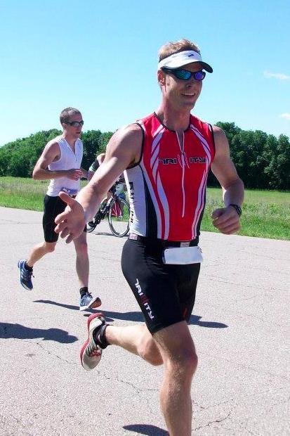 Mark running during Ironman 70.3 Kansas.
