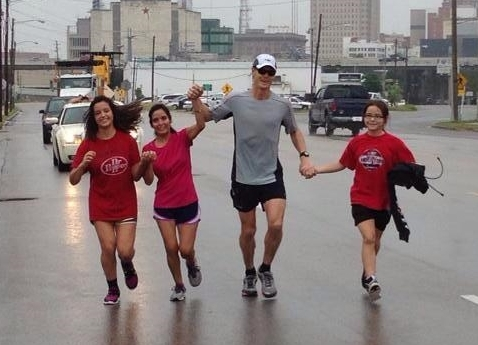 Mark Junkans finishing the first Run 4 The City with his family - 119 miles in 24 hours
