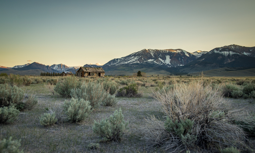 Description: While driving South on Highway 395 in the Eastern Sierras, the late afternoon sun was just finishing capping the 14,000 foot peaks with a beautiful golden light. The abandoned homestead in the foreground added dimension and depth to what would still have been a beautiful scene.  Camera: Nikon D600 Focal Length: 30mm Shutter Speed: 1/125 sec Aperture: f/5.6 ISO/Film: 100 Capture: May 18th 2013 Location: 37.94744640199296,-119.10724639892578  Copyright Craig Luna  