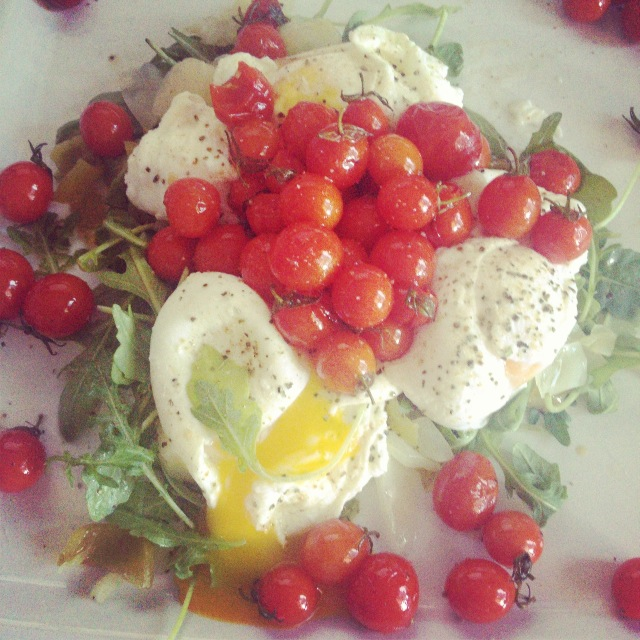 Arugula, sauerkraut, poached eggs, and roasted cherry tomatoes from the farmers market.