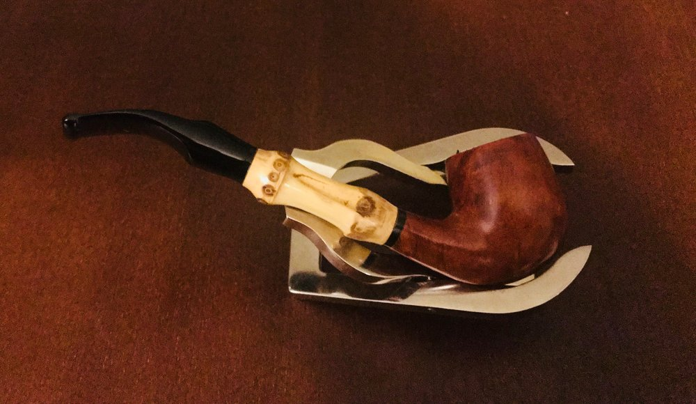 New Smoke. This is a  Forseti  Bamboo Pipe. Very nice pipe, small but perfect for the drive to work, or errand.