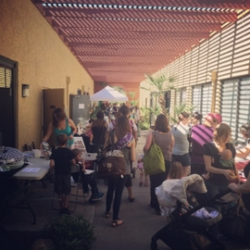 Families enjoying vendors and classes at Bump to Breast Fest 2015