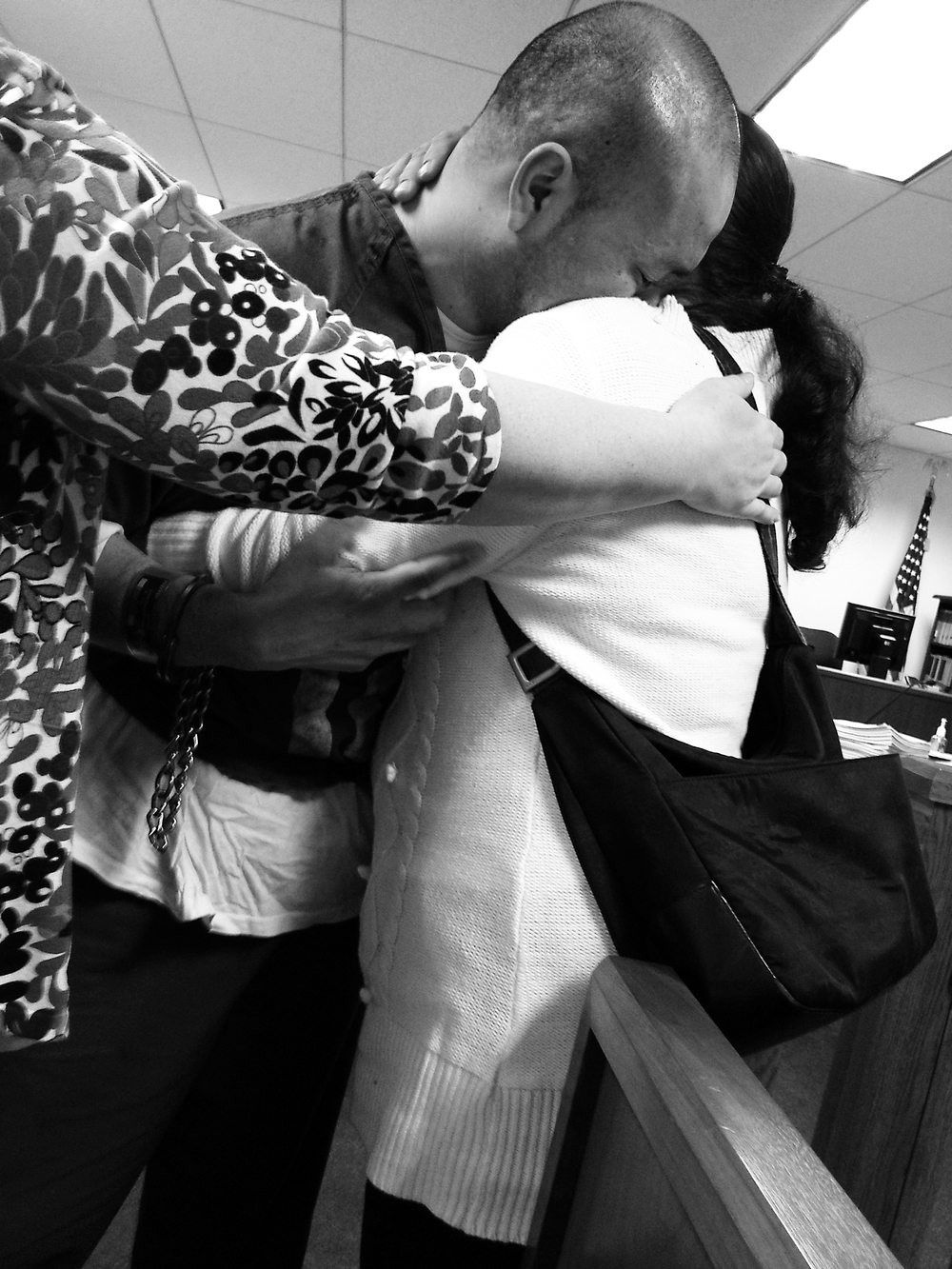 The practice of shackling immigrant detainees in courts is being challenged by immigrants' rights advocates. In this picture, he shares a momentary embrace with his mother.