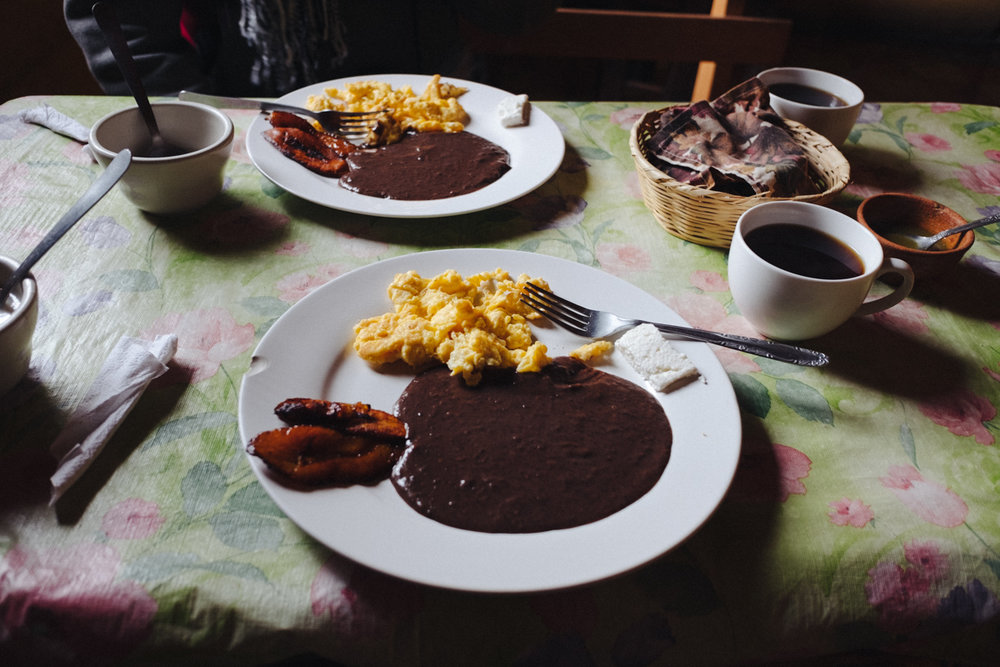 "The typical Maya desayuno (breakfast) includes scrambled eggs, black beans, a bit of queso blanco (white cheese), fried maduro plantains and a cup of ""cafecito"" (coffee). Additionally It's accompanied by a cloth covered basket of warm tortillas made of corn."