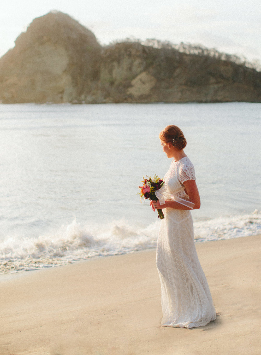 Bride at the beach in Aqua Nicaragua. Wedding photography.