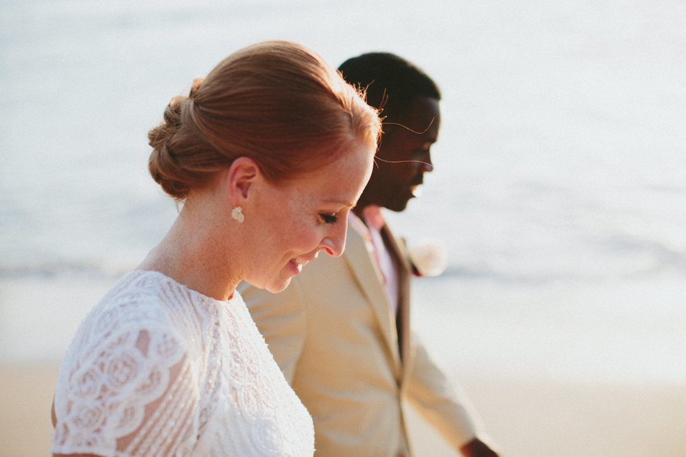Megan and Aquil walking down the beach after their wedding in Aqua Resort Nicaragua