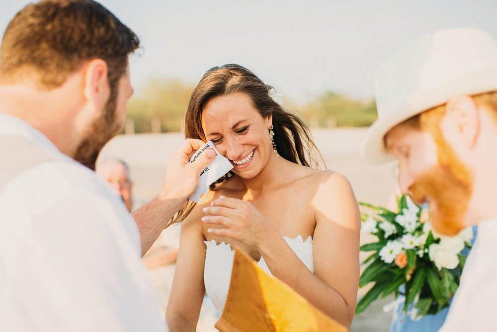 Groom wipes bride's tears in ceremony that took place in Popoyo beach Nicaragua