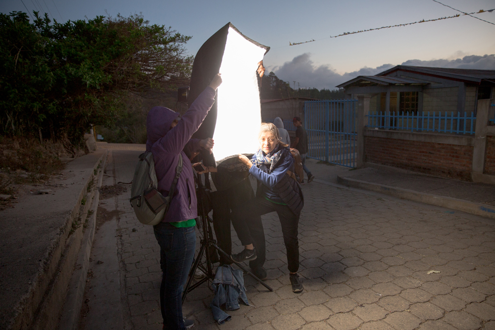 5 am. The wind appeared to be brutal that day. My friends from Fabretto Marketing Team struggling against heavy gusts of wind while helping me to sustain the lights. Thanks girls!!