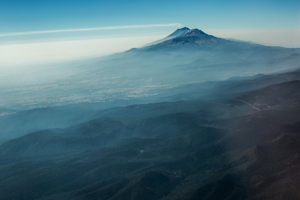 Two volcanoes nearby the Mexico City - Iztaccíhuatl and Popocatépetl (or just Popo and Izta) - According to Aztec mythology, those two volcanoes which are located near Mexico City were once living humans – a man and woman who were deeply in love. They later transformed into the volcanoes, which are now seen as symbols of their love.