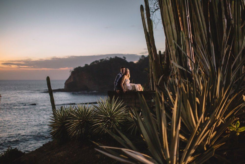 Destination Wedding photography in Costa Rica. Portrait of Newlyweds at the cliff at dusk.