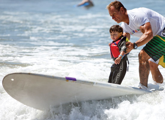 Photo Source: The Argonaut (On Aug. 6, Venice nonprofit ALL'SWELL hosted surfing lessons for disabled or chronically ill children)