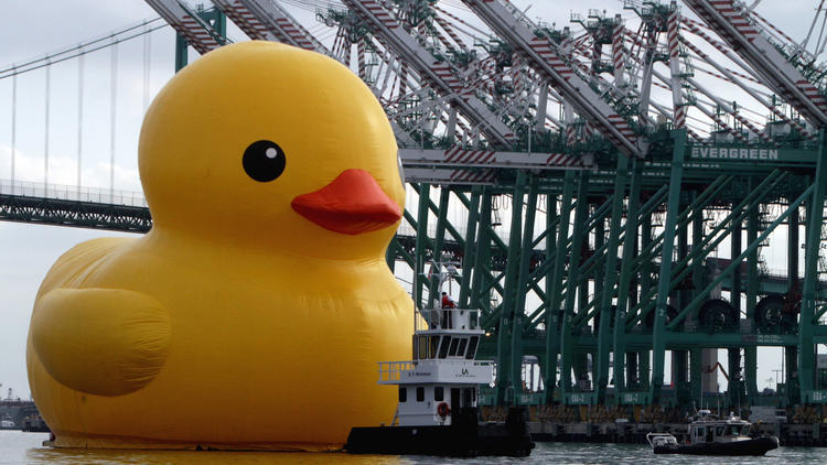 The big Rubber Duck art project made an appearance at L.A.'s waterfront Wednesday morning before the parade. (Bob Chamberlin / Los Angeles Times)