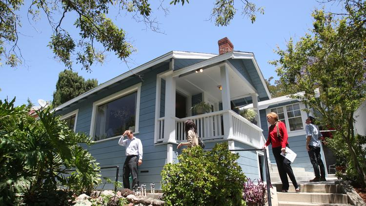 Potential buyers visit an open house in Highland Park. A new survey finds most Millennials plan to own a house someday. (Allen J. Schaben / Los Angeles Times)