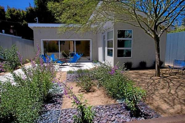 In the back garden of Theodore Payne Native Plant Garden Tour's No. 34 in Del Rey are permeable areas of hardscape, purple-flowering penstemons and a palo verde tree. Courtesy of the homeowner J Shields