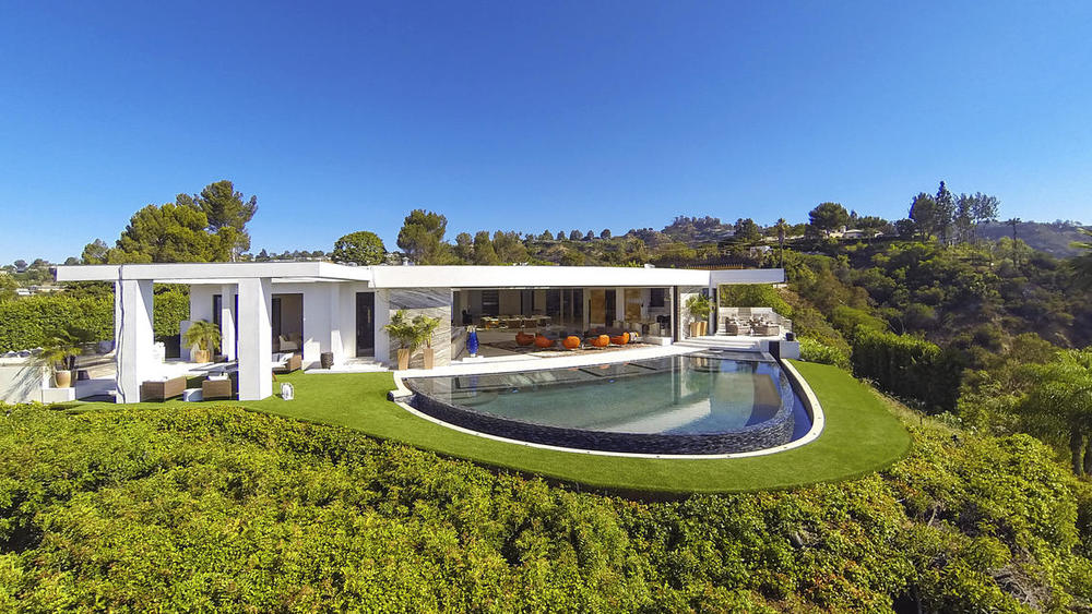 """""""Minecraft"""" creator Markus Persson, a Swedish tech billionaire, forked over $70 million in December for this custom mansion in Beverly Hills. It's fitted with iPad-controlled fountains, vodka and tequila bars, a $200,000 candy room and an onyx dining table for 24. (Simon Berlyn)"""