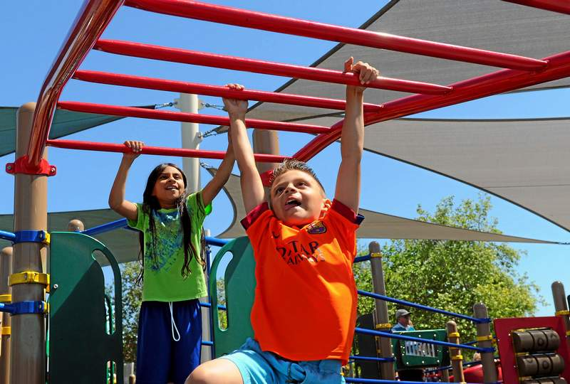 Andrew Aguirre climbs the monkey bars at Lake Balboa Park, Monday, March 30, 2015. (Photo by Michael Owen Baker/L.A. Daily News)