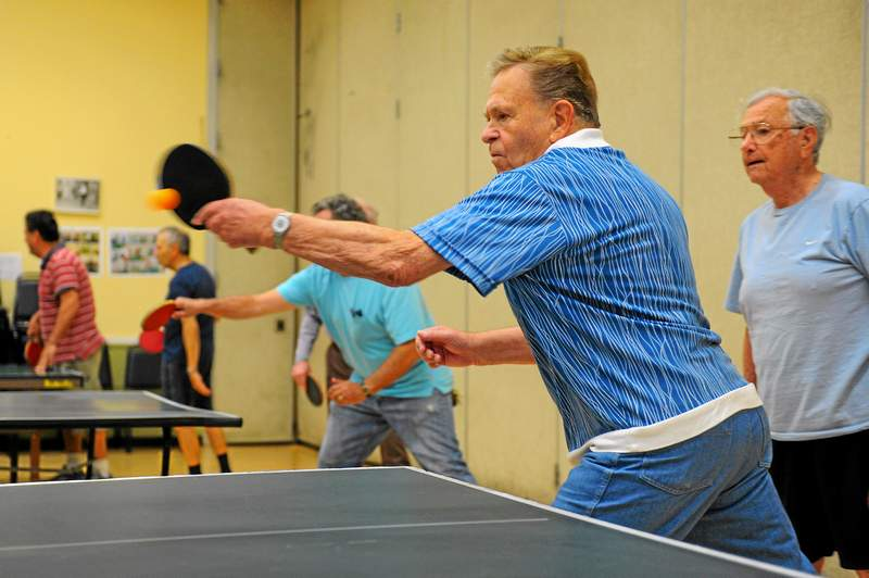 Frederick Czech returns a shot while playing table tennis with seniors at ONEgeneration Senior Enrichment Center in Reseda, Monday, March 30, 2015. (Photo by Michael Owen Baker/L.A. Daily News)