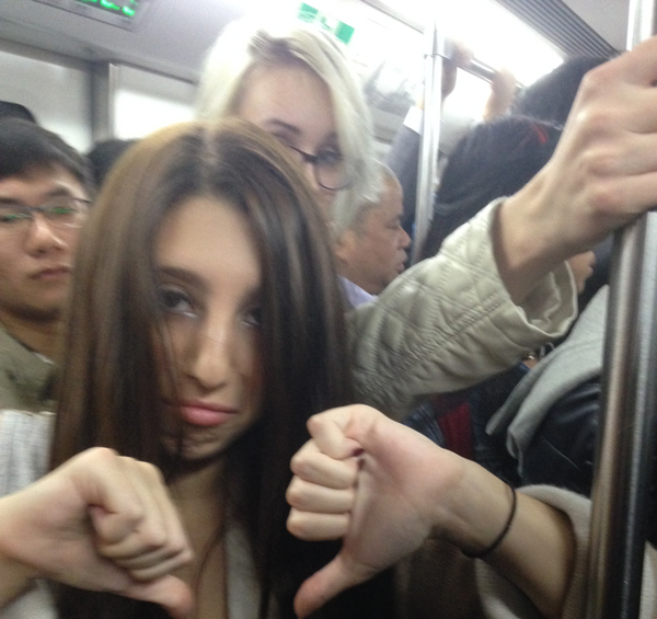 Riding the subway during rush hour is no bueno!.
