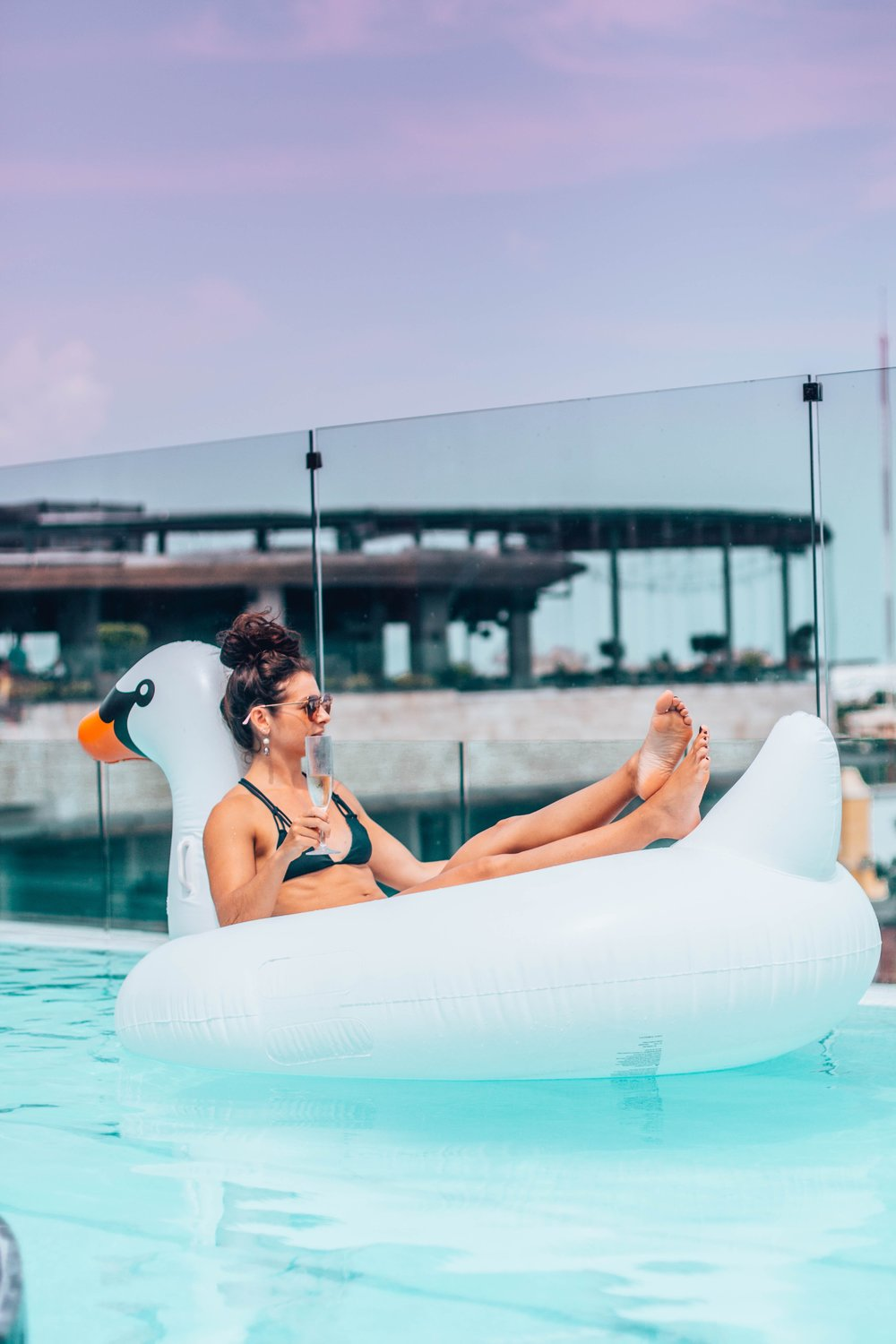 Chilling with Prosecco on a Swan Floatie!