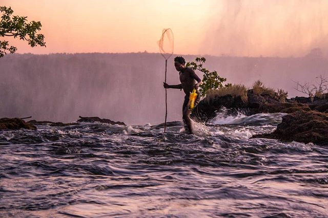 Sunset fishing on the edge of Victoria Falls. 📷 2015 #zambia #victoriafalls