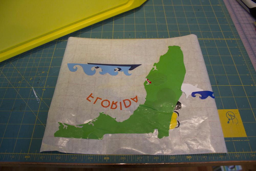 cover with the back of the transfer tape and store. i tape the edges so that it stays flat.