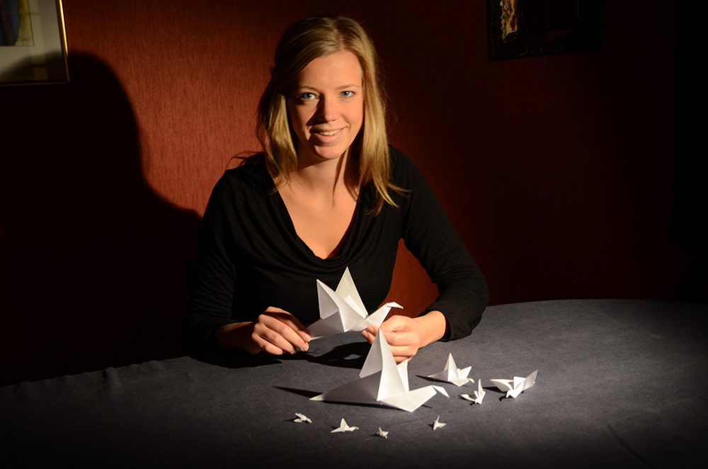 Kaja Swensen with Origami birds she produced with Paul Strohmeier for COCA 201.