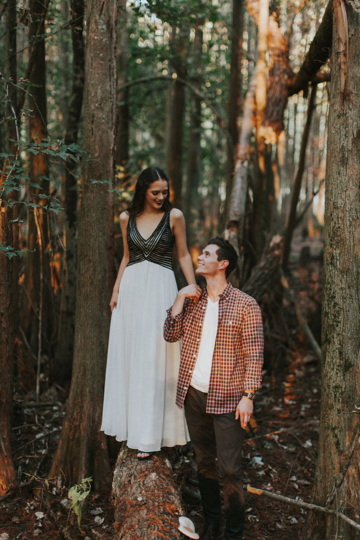 adventurous couple forest