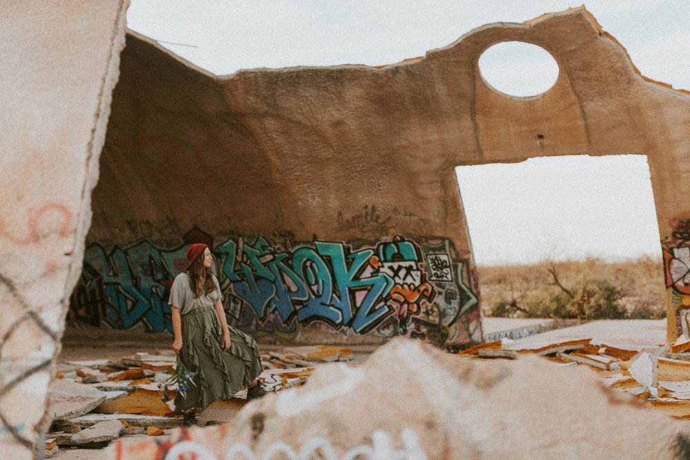 Someone left a bouquet of flowers in the rubble, posing with them for the heck of it.